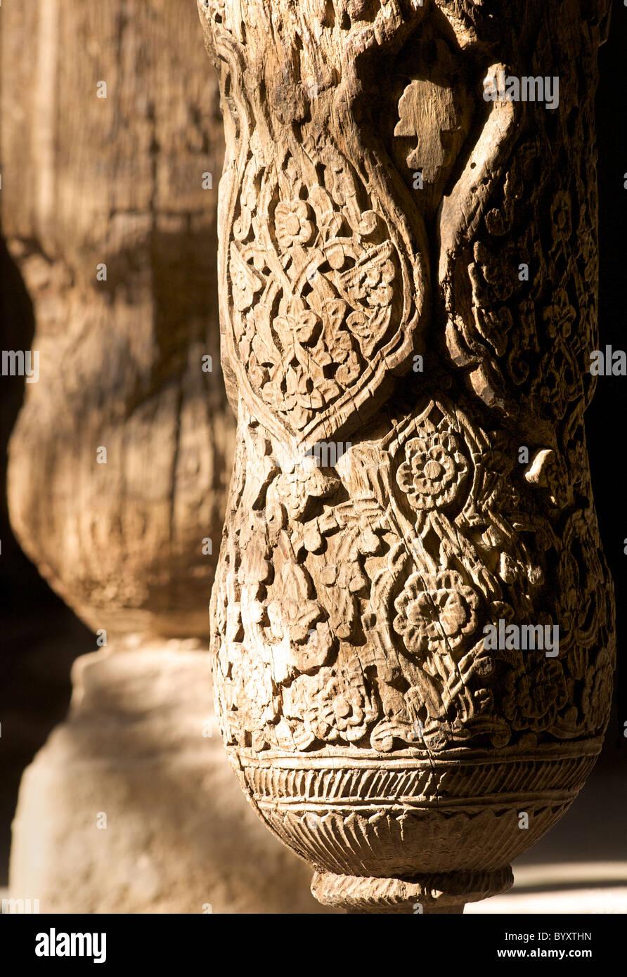 Carved wooden pillars inside the Juma Mosque, Khiva, Uzbekistan - Stock Image
