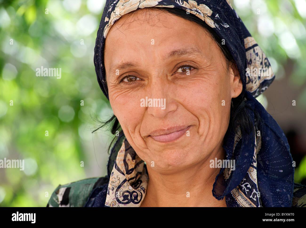 Portrait of a friendly woman selling at market, Khiva, Uzbekistan. Uzbeki style dress. RELEASED  (please enquire - Stock Image