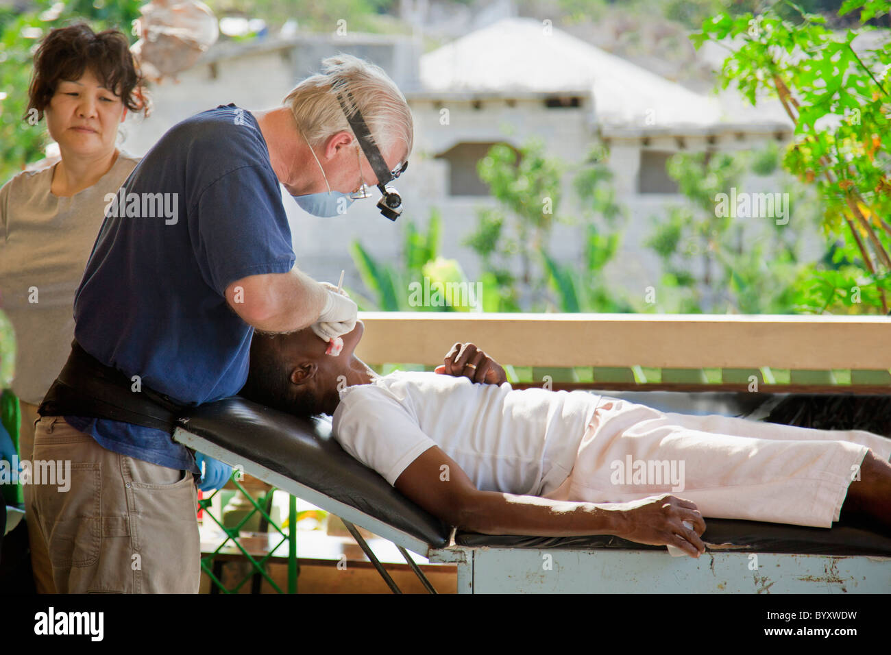 a dentist volunteers his dentistry to help haitians living in poverty; grand saline, haiti - Stock Image