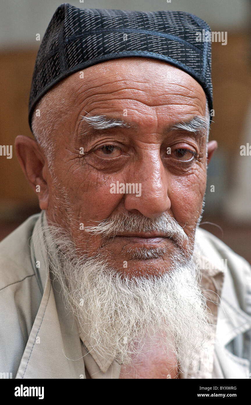 Portrait of  elderly muslim man. The Muezzin at a mosque, Khiva, Uzbekistan. MODEL RELEASED ( ask Photographer if - Stock Image
