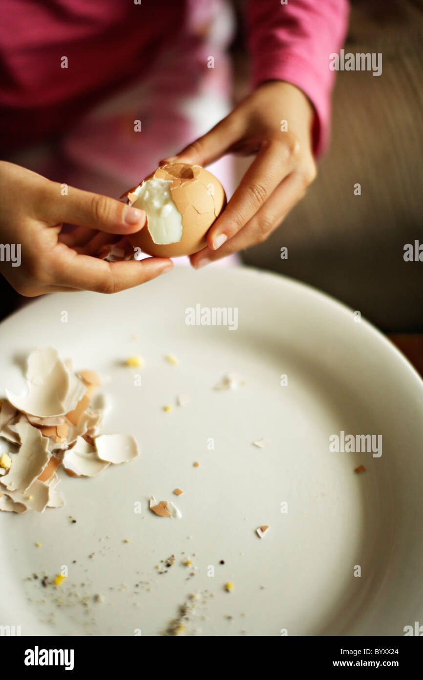 Girl eats hard boiled eggs. - Stock Image