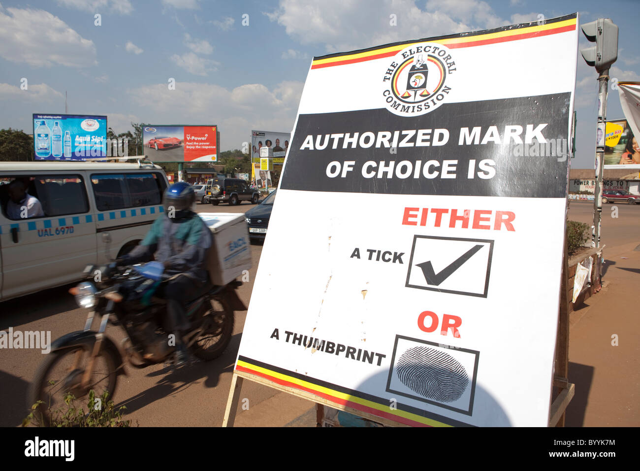 The streets of Kampala, Uganda's capital city, are dotted with campaign messages ahead of the presidential election - Stock Image