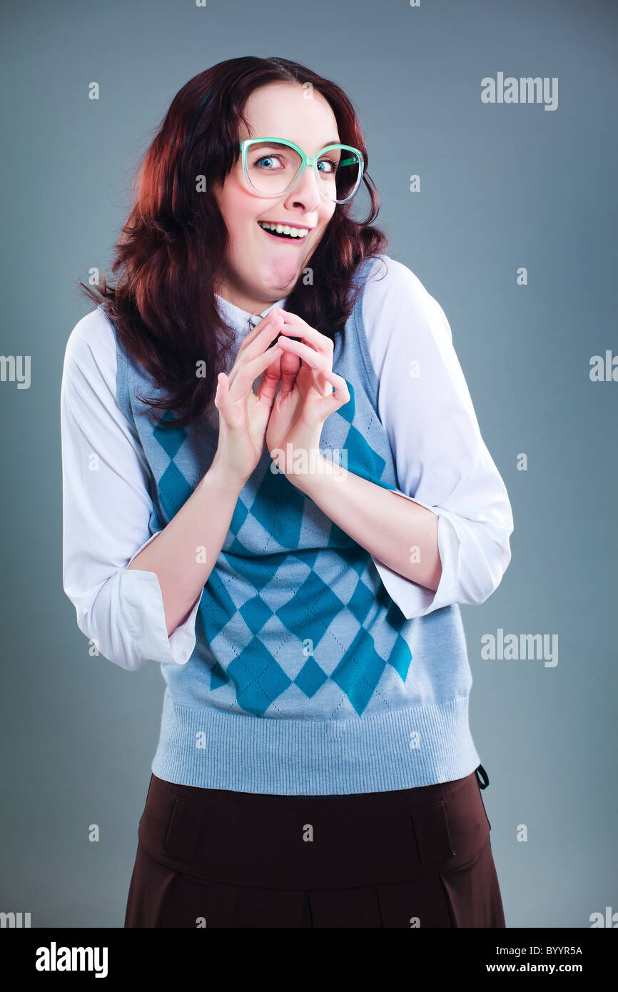 Geeky girl has a clever plan that she is very pleased about - Stock Image