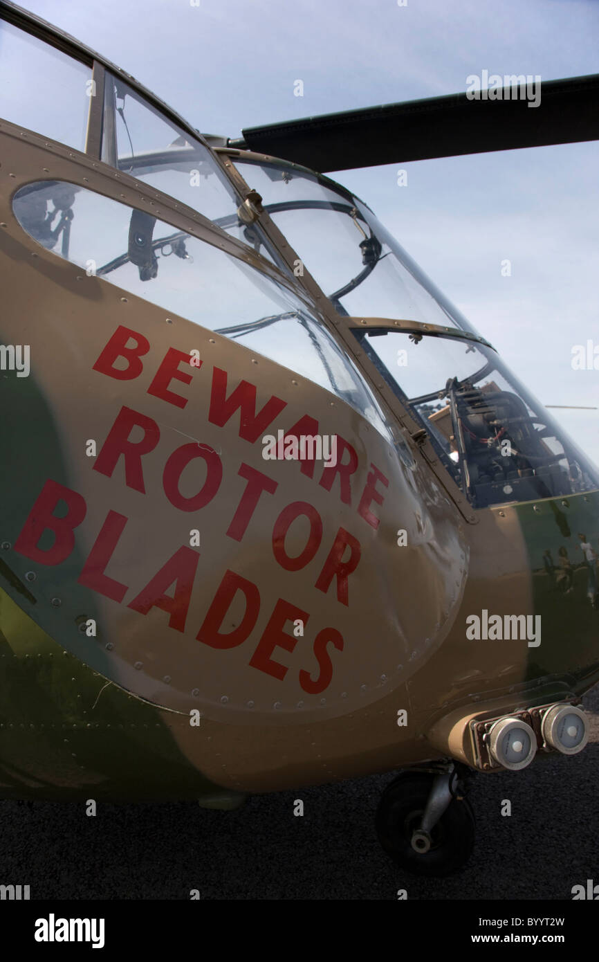 Sign on door of small helicopter, 'Beware of Rotor Blades' - Stock Image