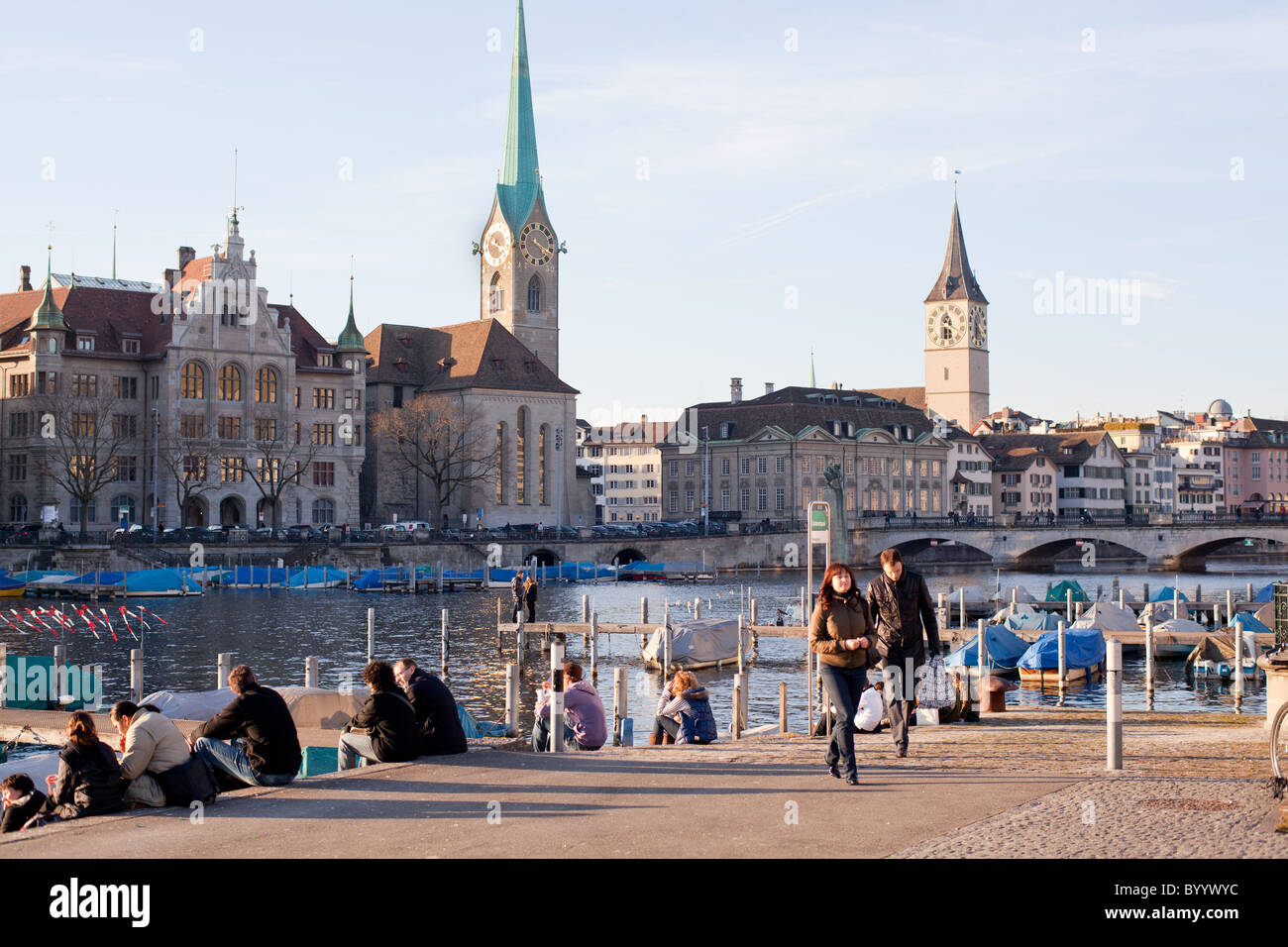 people enjoying weather, waterfront, Limmat River, Zürich, Switzerland - Stock Image
