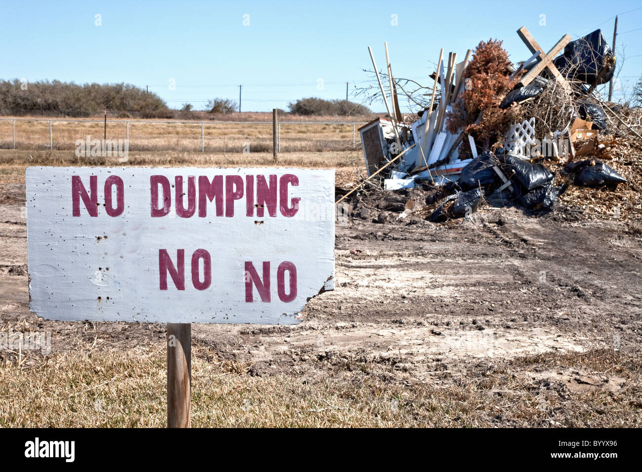 Sign 'no dumping', trash piled - Stock Image