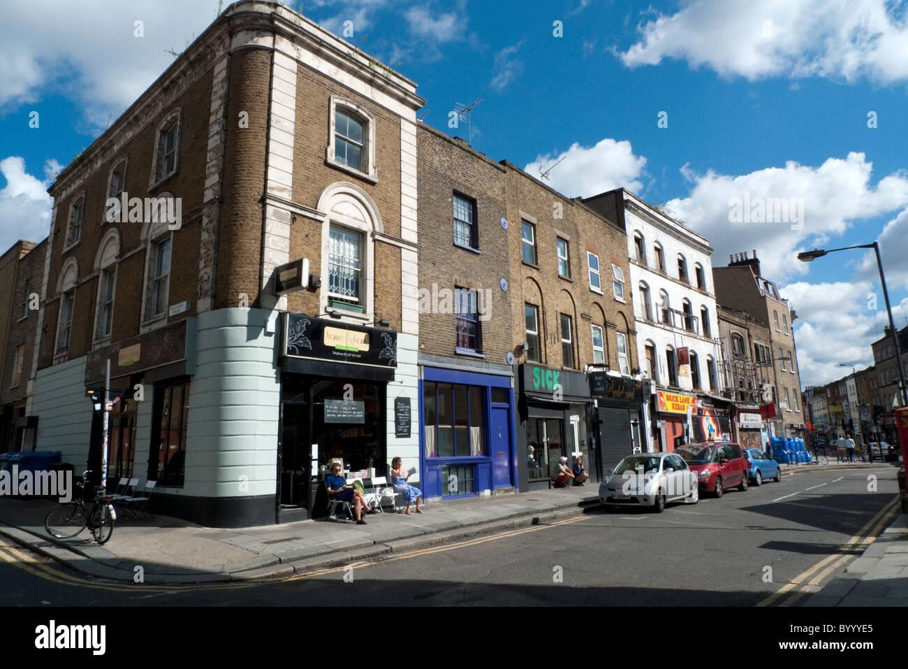 People drinking coffee sitting outside Franze & Evans cafe in Redchurch Street near Brick Lane East End, London Stock Photo