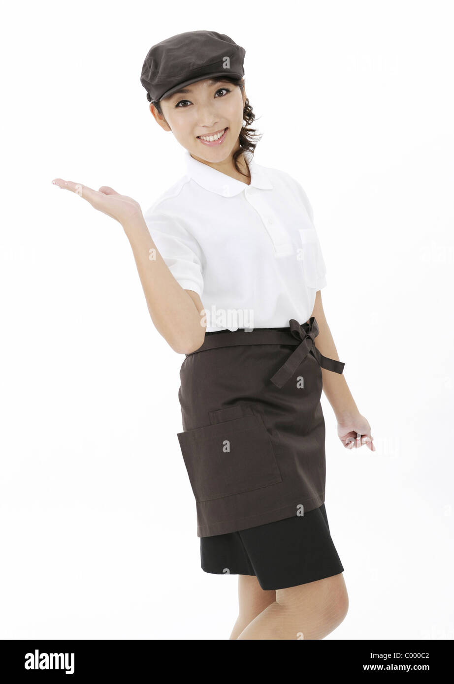 Waitress showing something - Stock Image