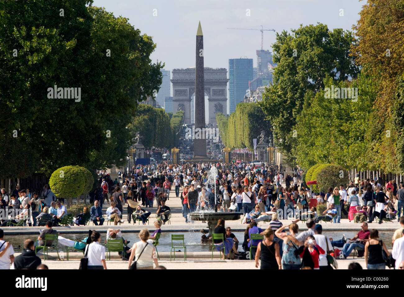 The Obelisk of Luxor and the Arch de Triomphe at the west end of the Avenue des Champs-Elysees in Paris, France. - Stock Image