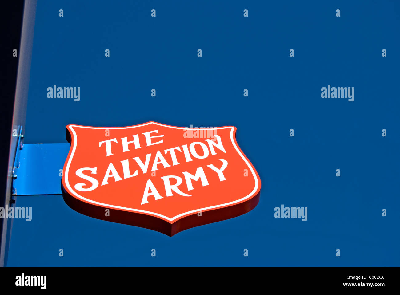 salvation army sign in shape of shield outside a branch of the army's charity shop in new malden, surrey, england - Stock Image