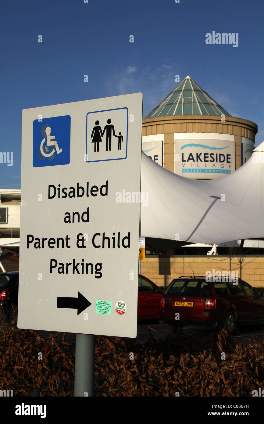 Disabled child and parent parking notice. - Stock Image