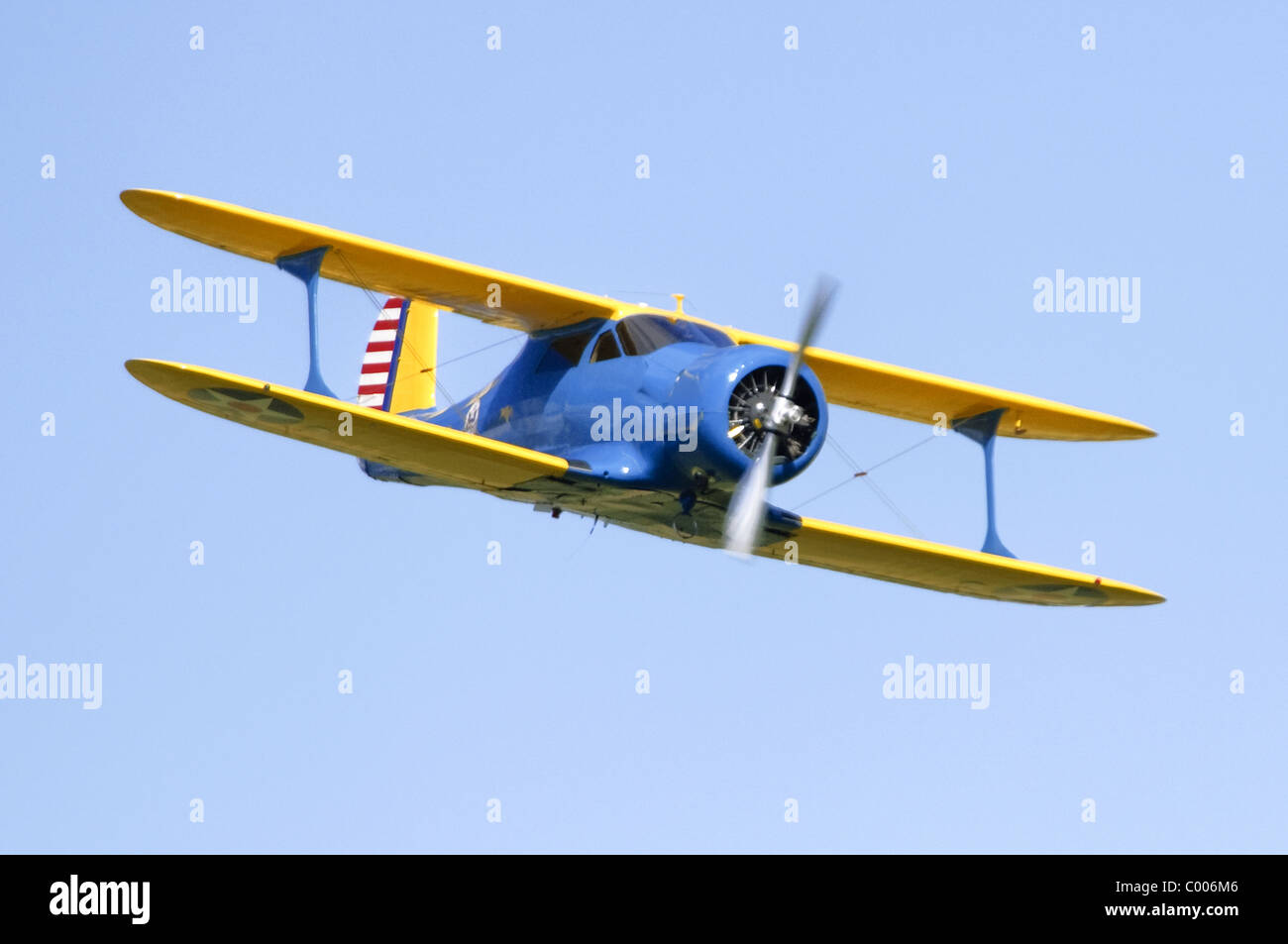 Beech YC-43 Traveller (Staggerwing) biplane making a low flypast at Duxford Flying Legends Airshow - Stock Image