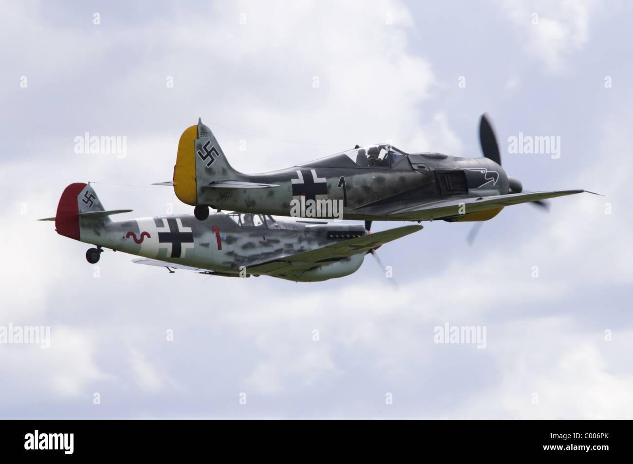 Messerschmitt Bf 109G (Hispano HA-1112 MIL Buchon) & Focke Wulf FW190 making a low flypast at Duxford Flying - Stock Image