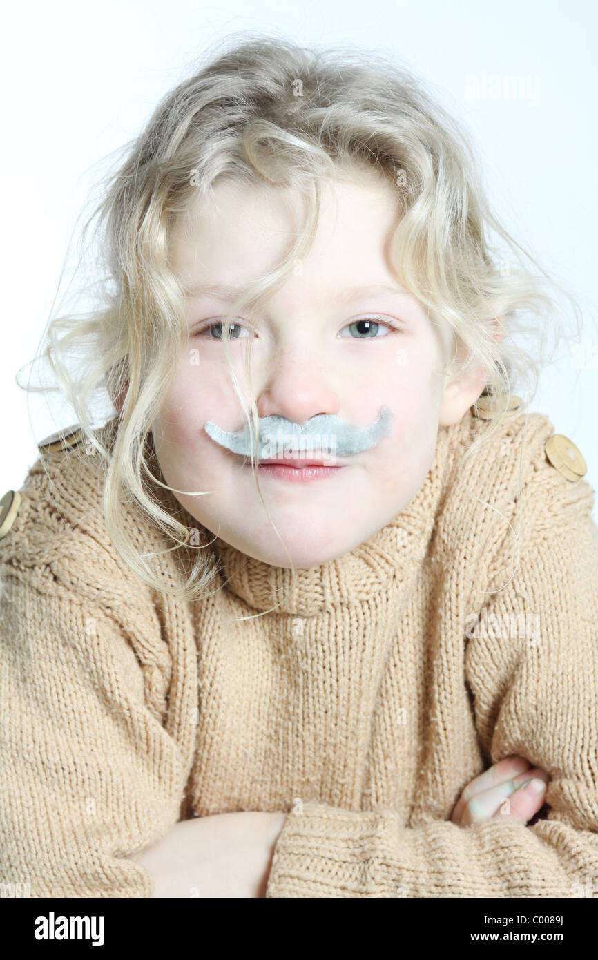 A blond girl with a grey moustache stuck on, hunched over pretending to be an old lady. Stock Photo