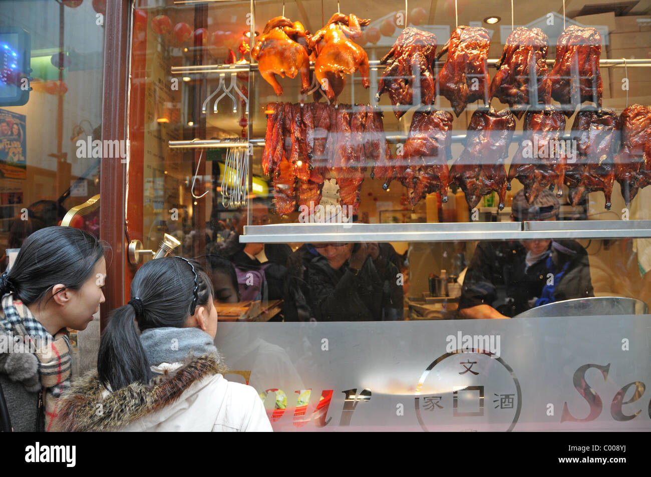 Crispy duck Chinese food roast duck chinatown Chinese New Year Celebrations Chinatown London - Stock Image
