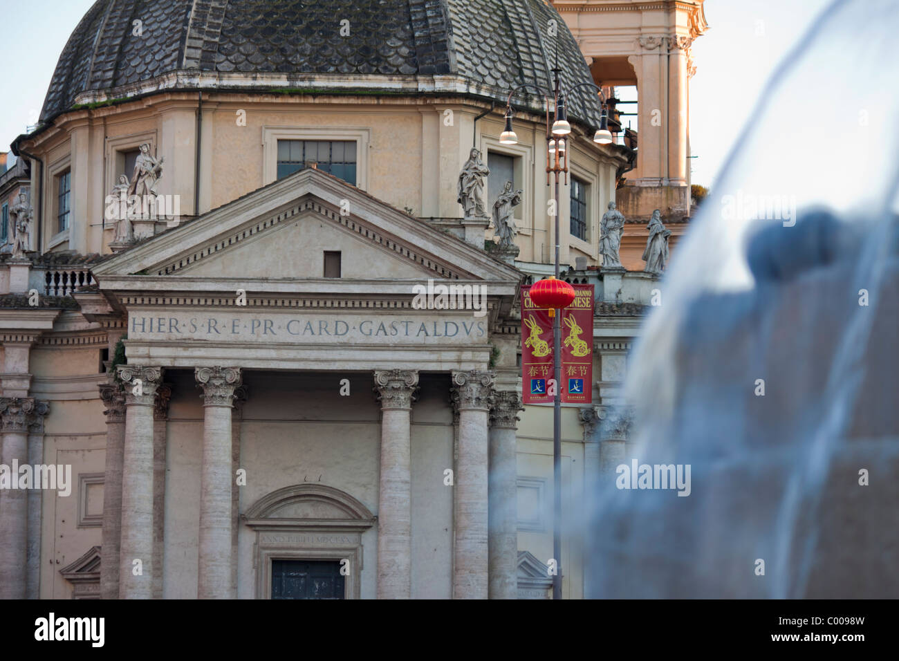 facade of the church of santa maria in montesanto in piazza del popolo rome a banner for chinese lunar new year is visible