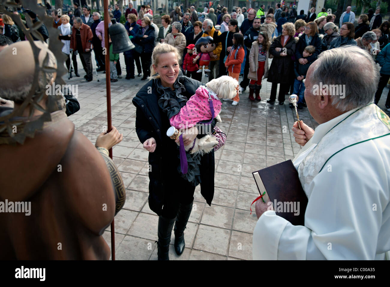 pet owners waiting  for their pest to be blessed in puerto pollensa in spain - Stock Image