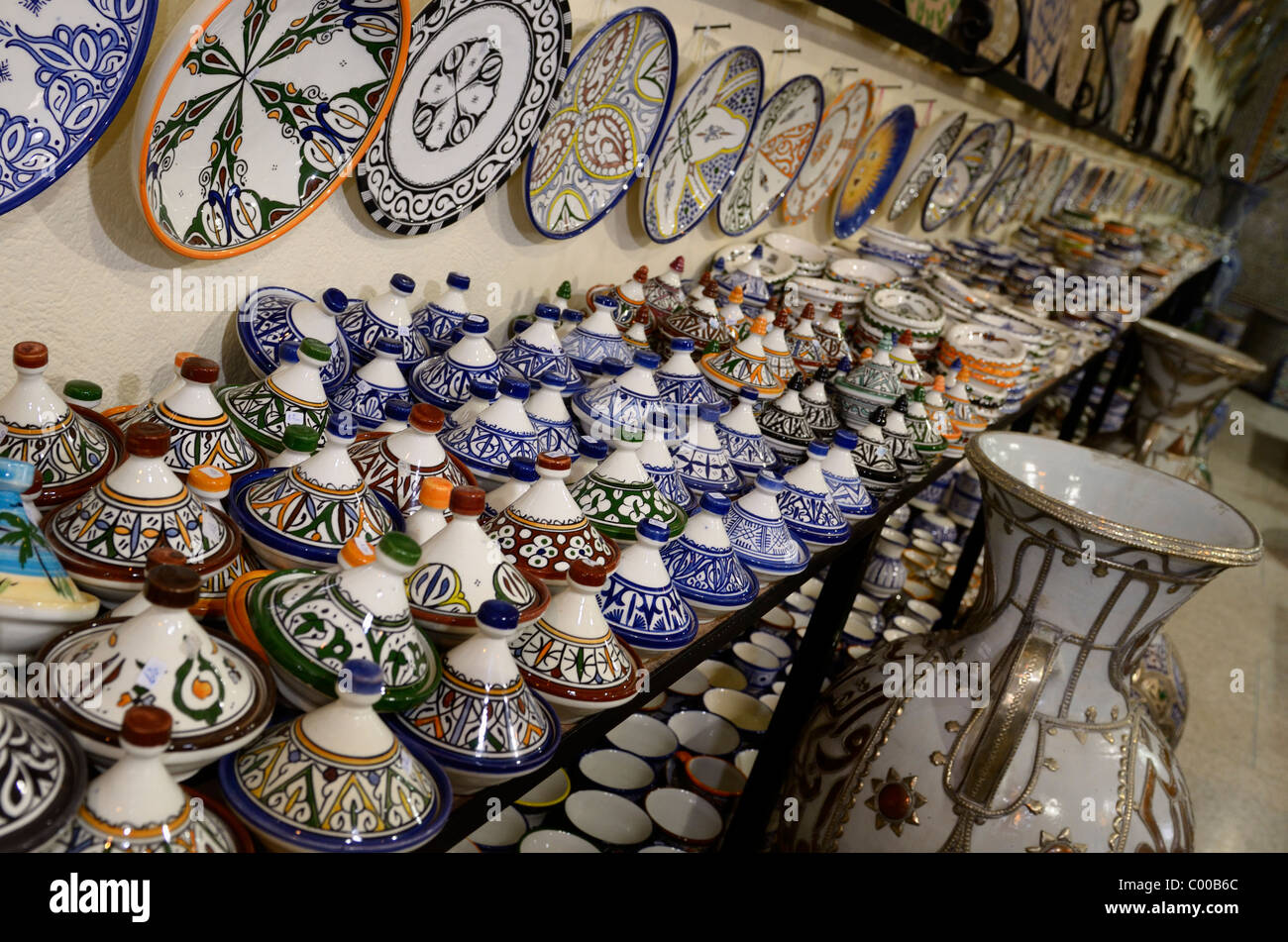 Brightly colored tagine bowls and plates in a ceramic shop in Fes el Bali Medina Morocco - Stock Image