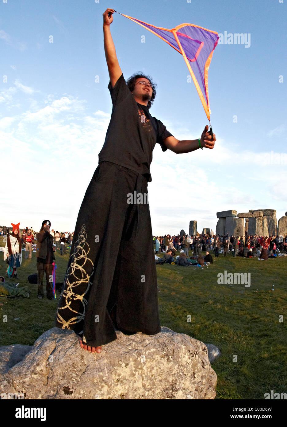Festival Goer With Flag At The Summer Solstice Stonehenge UK Europe - Stock Image