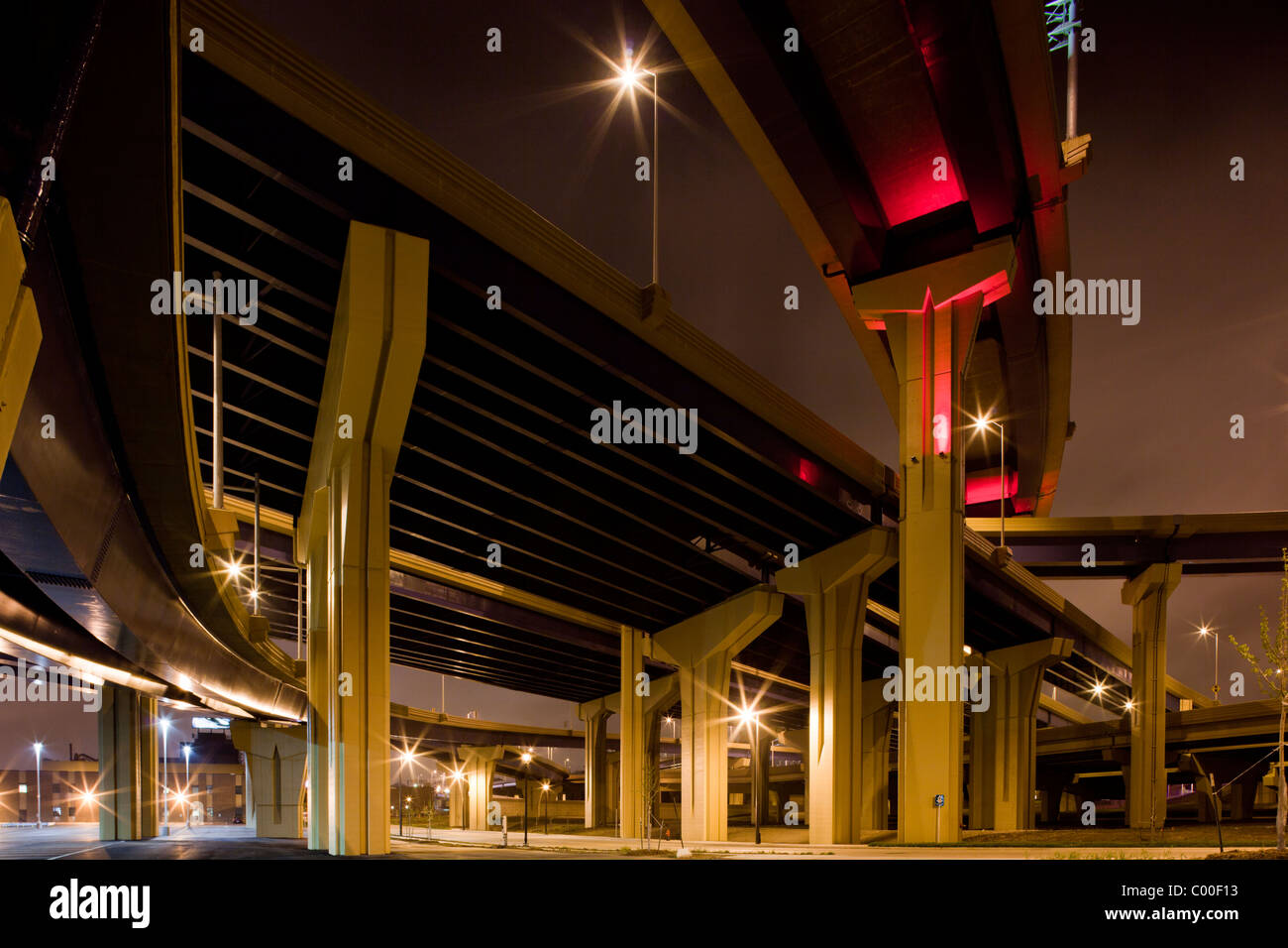 USA, Wisconsin, Milwaukee, Towering concrete highway overpasses near downtown on spring evening - Stock Image