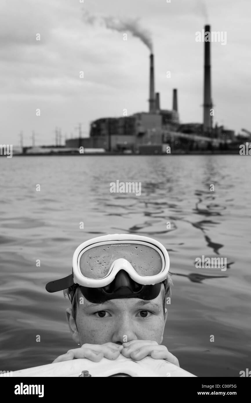 USA, West Virginia, Mount Storm, Young boy swimming in Mount Storm Lake heated by effluent from Mount Storm Power - Stock Image