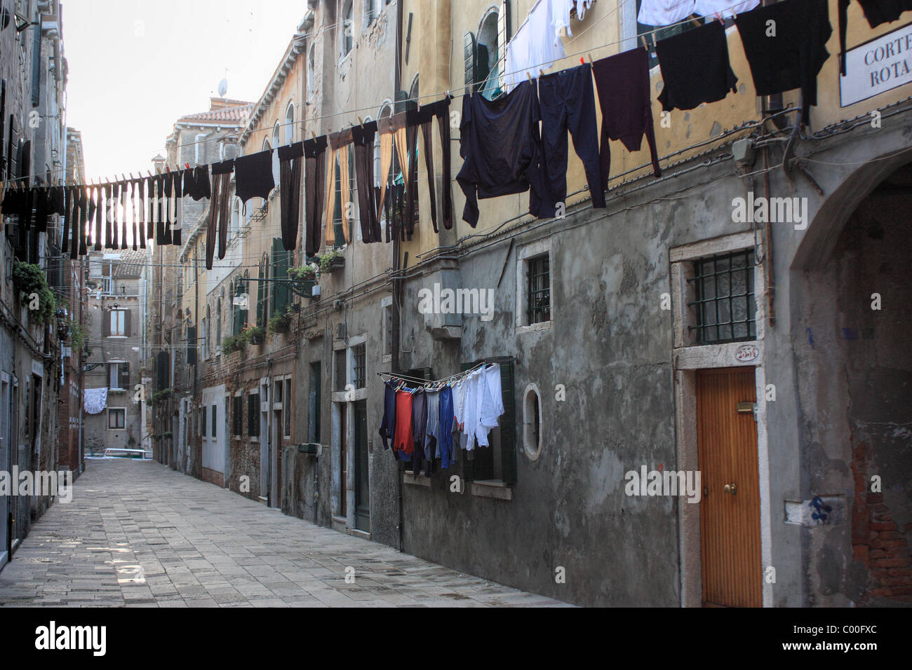 Clothesline in a dark street - Stock Image