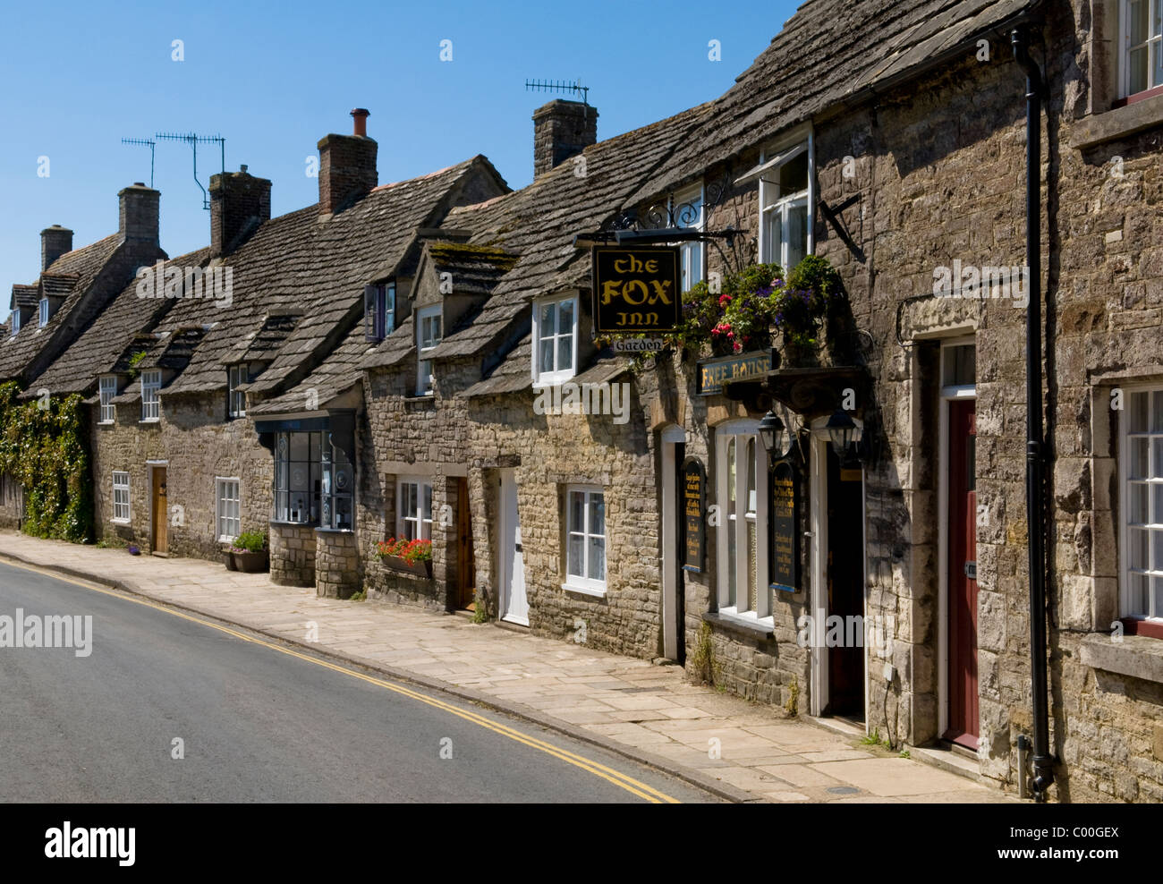 Old houses and pub in Corfe Castle Village Dorset - Stock Image