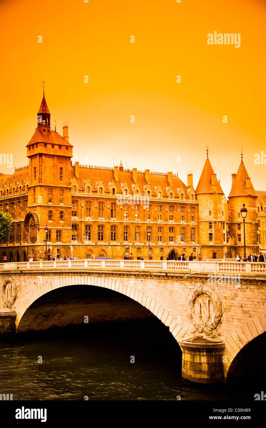 Pont au Change bridge and Conciergerie at sunset in Paris - Stock Image