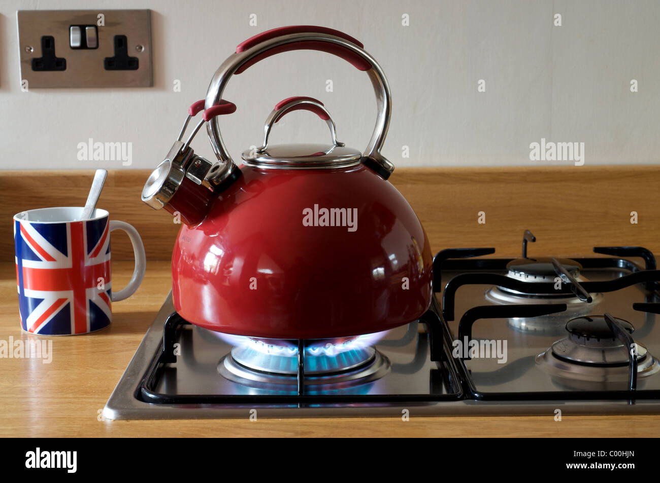 Gas kettle on hob - Stock Image