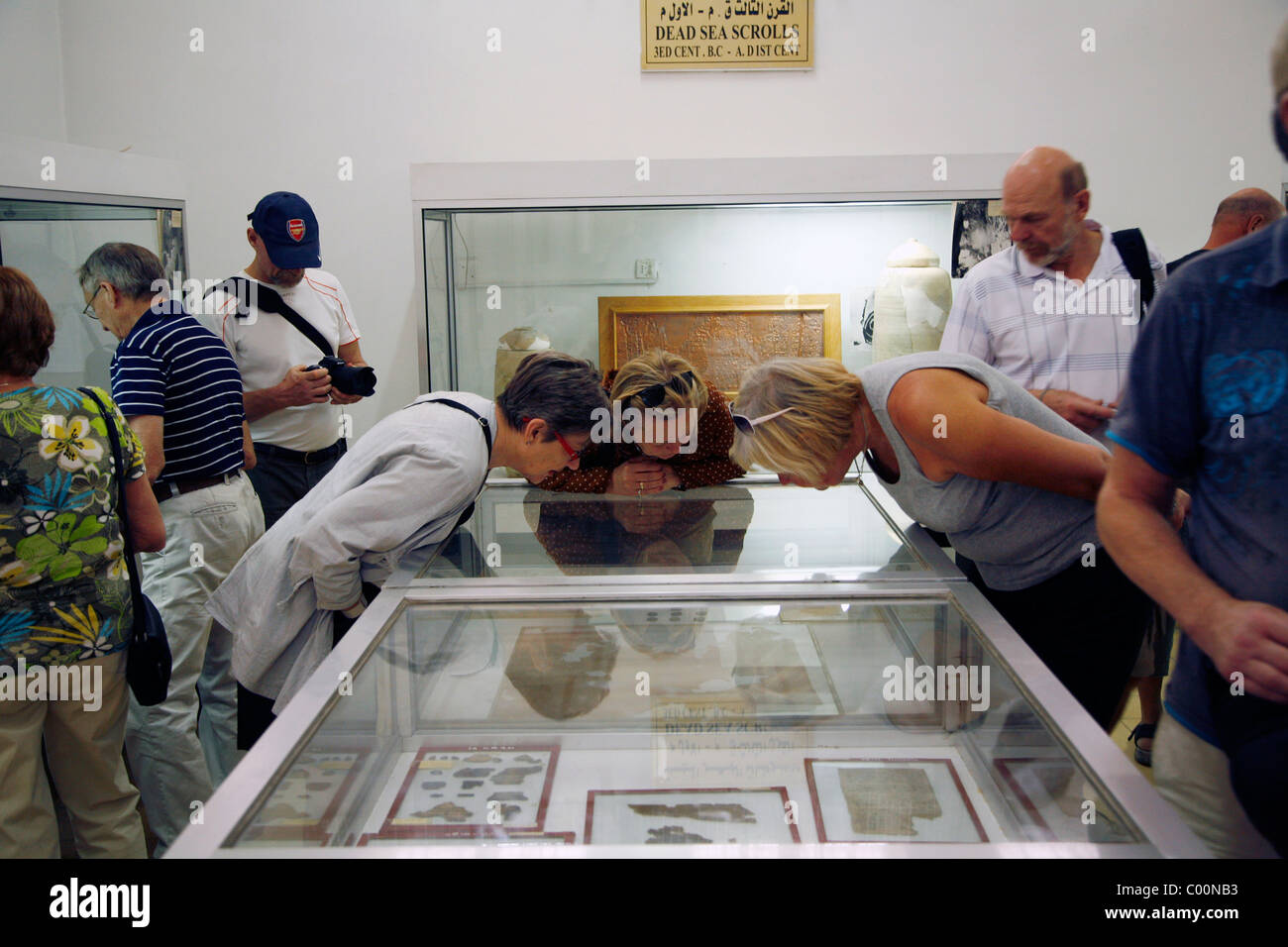 Tourists looking at the Dead Sea Scrolls at the National Archeological Museum in the Citadel, Amman, Jordan. - Stock Image