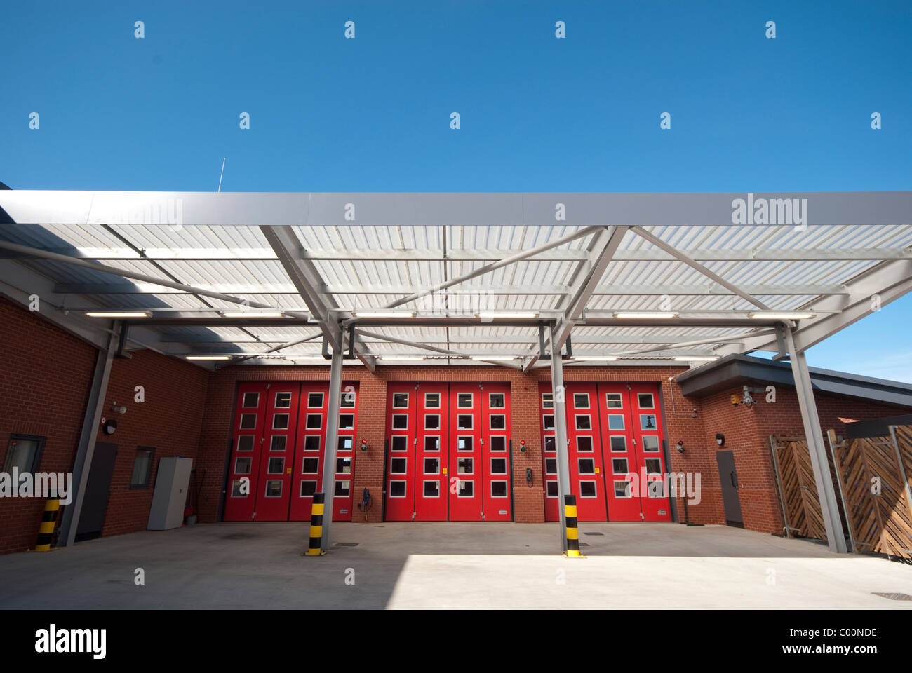 Marshes End Fire Station, Dorset Fire and Rescue Service, Poole fire engine exit doors Stock Photo