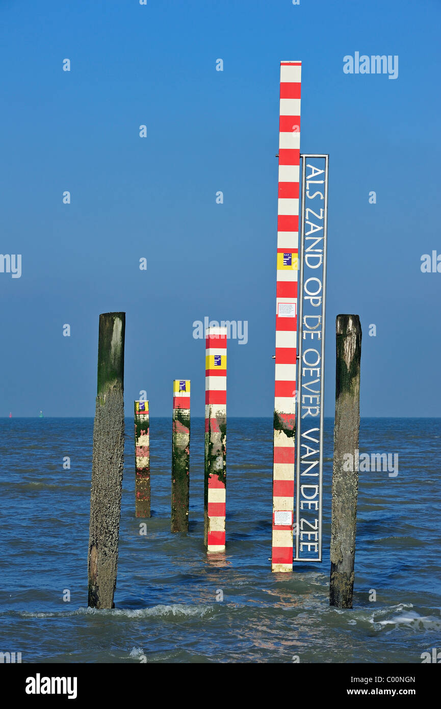 Sea tide depth measure / water level gauge on beach at low tide, Zeeland, the Netherlands - Stock Image