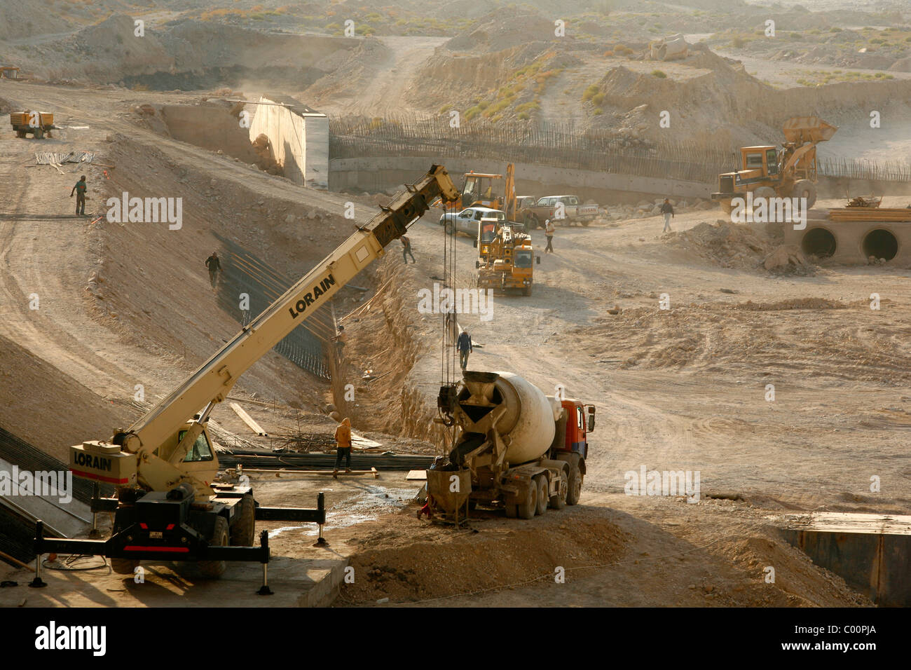 Construction work of a dam that will lead the water collected in Wadi mujib into the dead sea, Jordan. - Stock Image