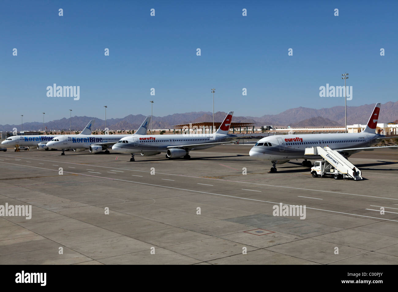Aircraft stand on the runway at Sharm el-Sheikh International Airport in Egypt. - Stock Image