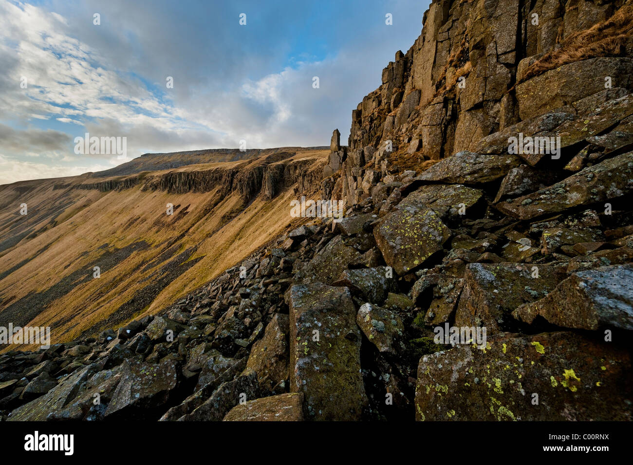 Crags on the North side of High Cup Nick - Stock Image