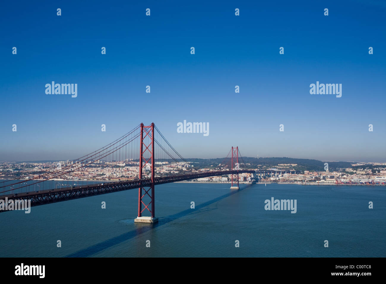 25th of April Bridge over Tagus River, built 1966, Lisbon, Portugal on other side Stock Photo