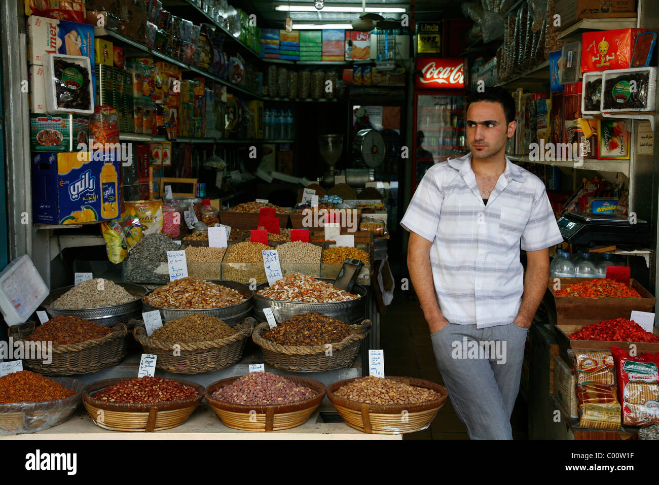 Nut shop and grocery shop in downtown Amman, Jordan. - Stock Image