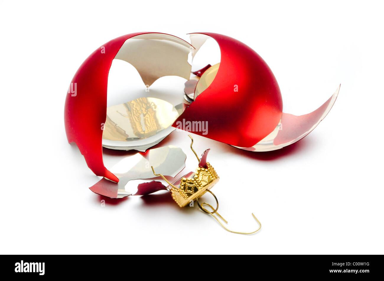 broken christmas ornament on white - Stock Image