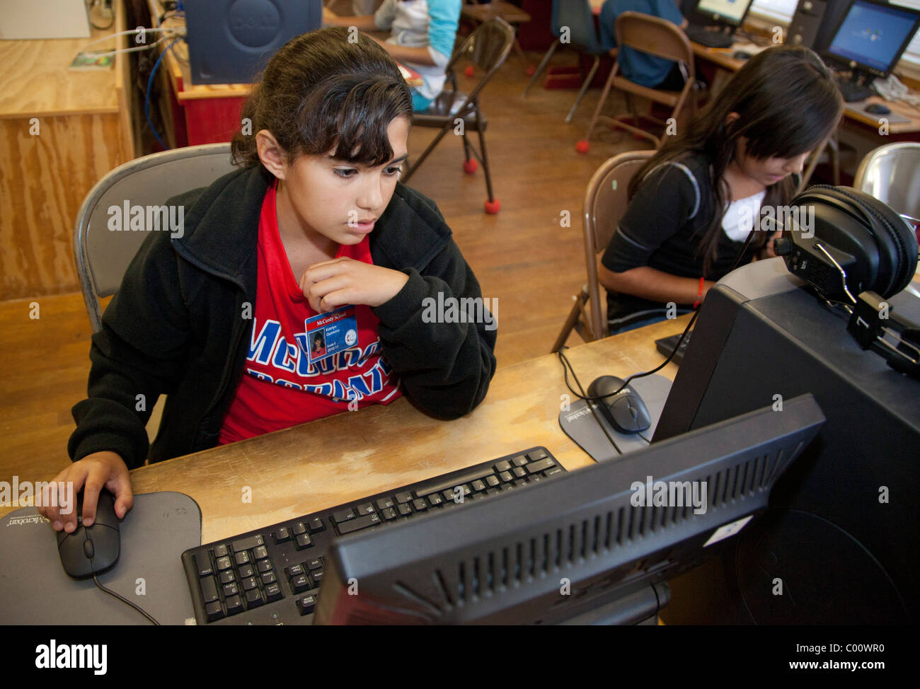 Fifth Grade Student in School's Computer Lab - Stock Image