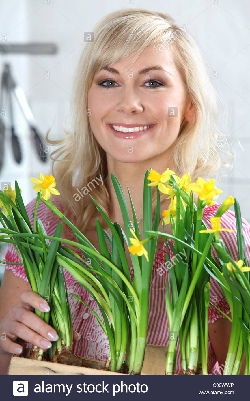 woman with daffodils Stock Photo