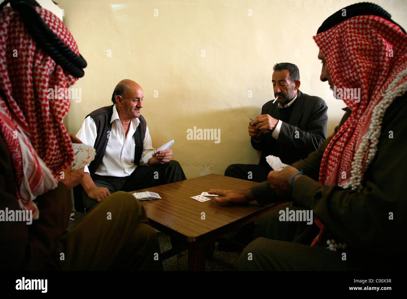 Men playing cards at a traditional cafe on Mayden street, Salt, Jordan. - Stock Image