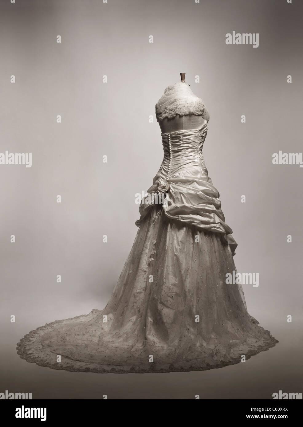 wedding dress by Ian Stuart photographed in the studio - Stock Image