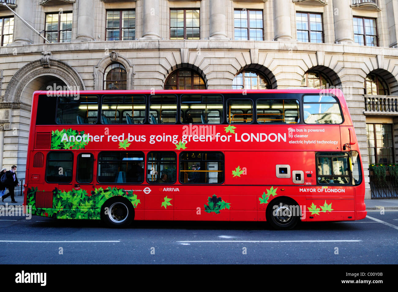Red Double Decker Bus powered by electric hybrid technology, London, England, UK - Stock Image