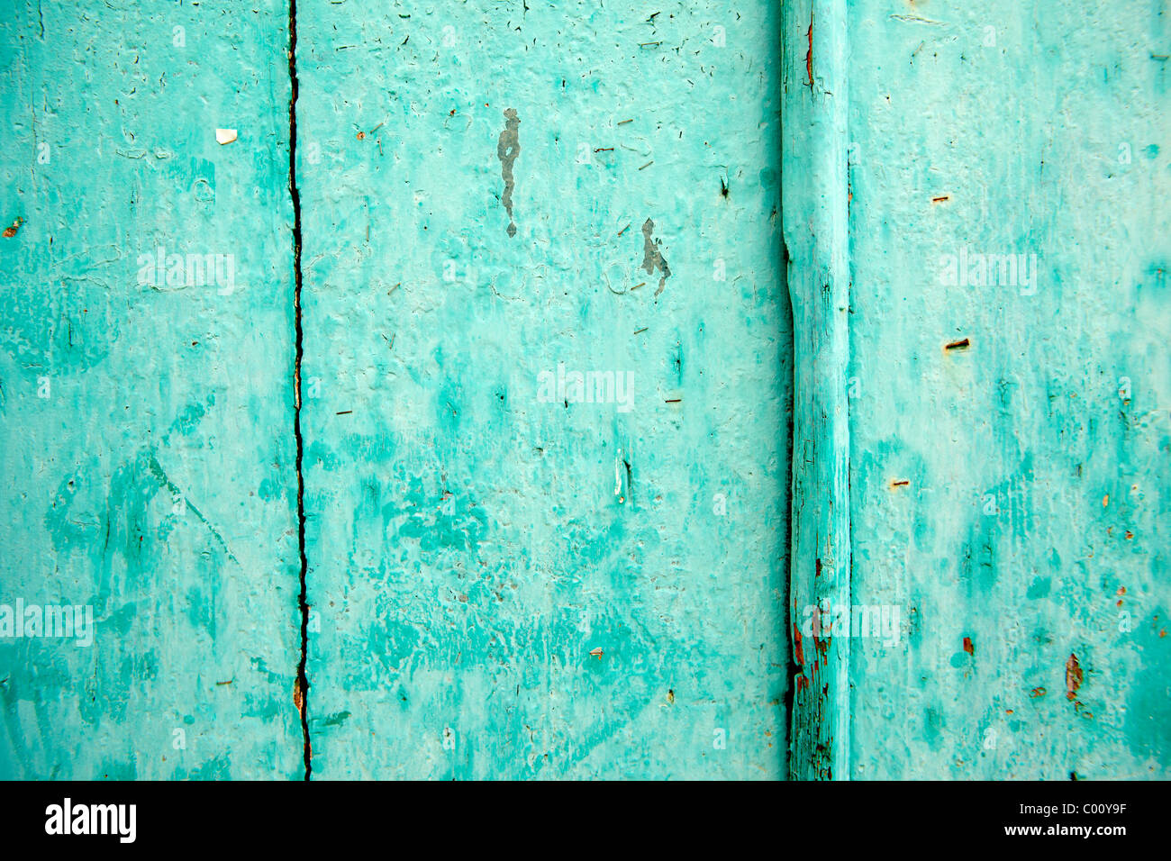 Turquoise painted door - Stock Image