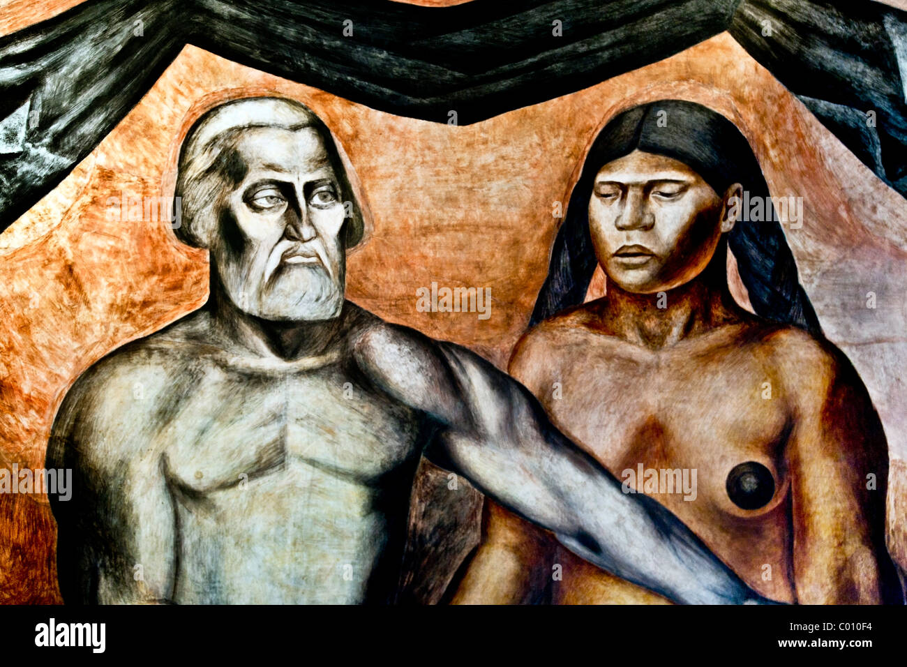 detail view Orozco mural of unsmiling grim Spanish conqueror Cortes with his bare breasted noble Indian mistress - Stock Image