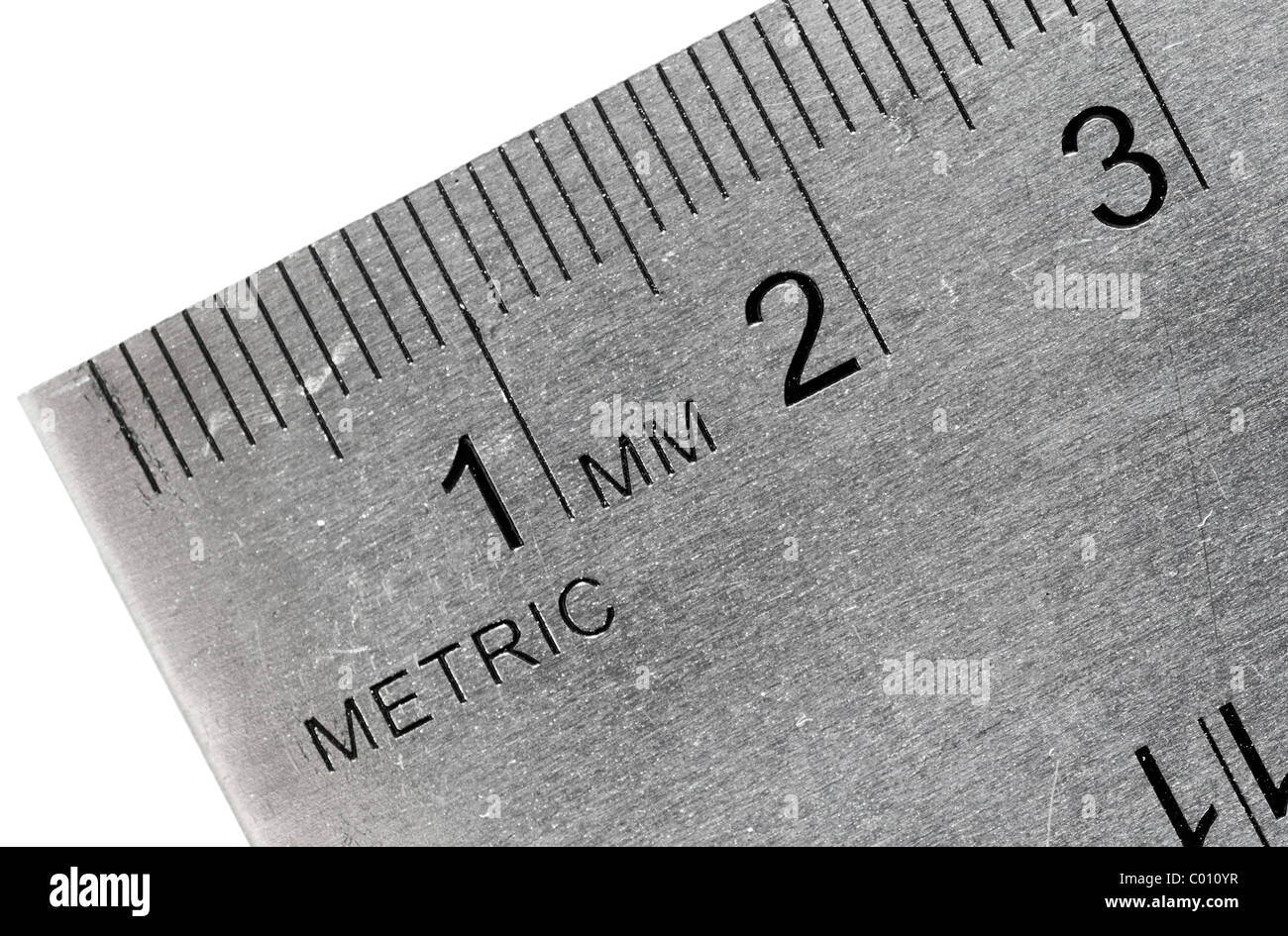 Macro shot of an industrial stainless steel ruler, metric side. Stock Photo