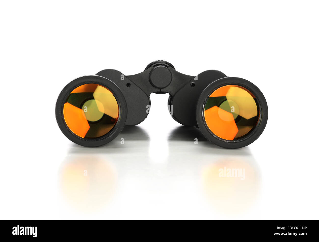 Binoculars over white background with reflections on foreground - Stock Image