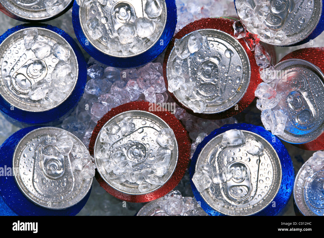 Photo of cans of drink on crushed ice. - Stock Image
