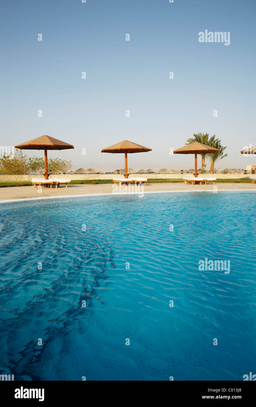 Pool with a blue water surface, sun lounges and sunshades, Soma Bay, Red Sea, Egypt, Africa Stock Photo