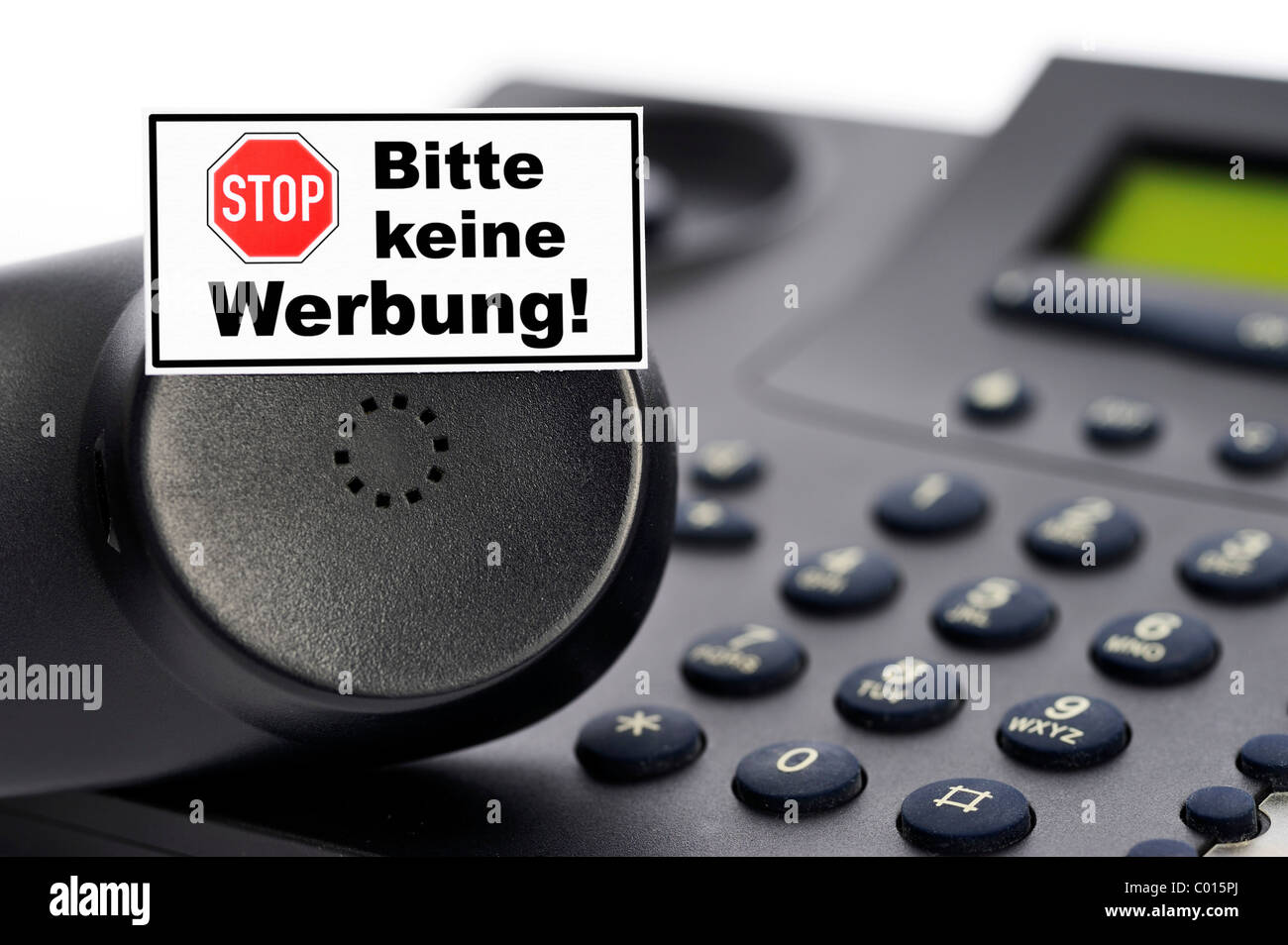 Phone and sign 'Bitte keine Werbung' or Please, no advertising, unauthorized phone advertising - Stock Image